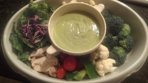 Avocado dressing, dip or appetizer drizzle over roasted chicken and onion lettuce wrap