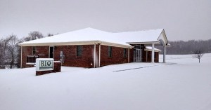 Picture of a snow-covered office building.