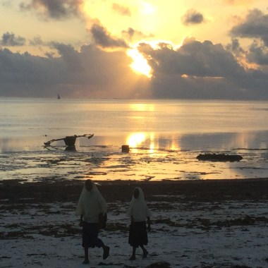 Zanzibar sunrise with school kids heading for class.
