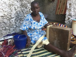 She puts HOURS into each basket, first weaving the long long strands then wrapping and sewing them carefully around the wooden block to create the shape.