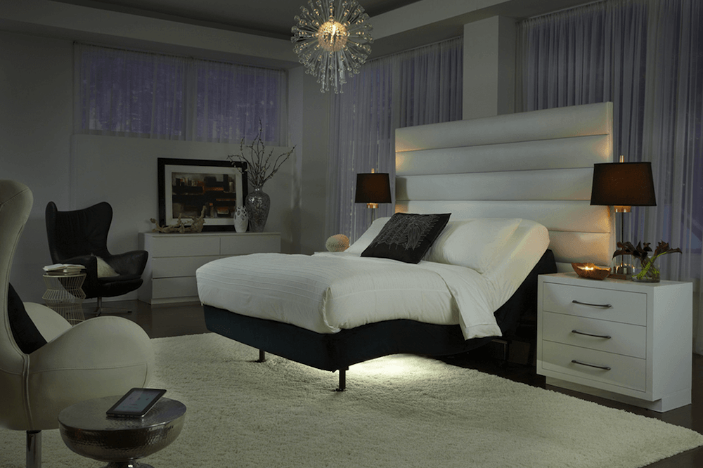 Beautiful bedroom with adjustable bed with light underneath it