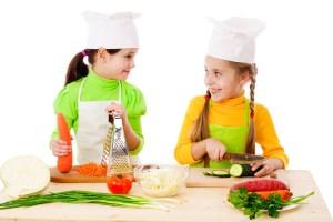 Two girls making salad