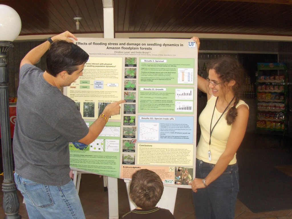 Scientists present their research to a future tropical ecologist at a conference in Brazil. (Photo: P. Delamonica Sampaio)