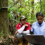 Center for International Forestry Research (CIFOR) researchers upload  data they've just collected in one of their plots.  Photo by Nanang Sujana for Center for International Forestry Research (CIFOR) and reproduced under the CC BY-NC-ND 2.0 license. For more information on CIFOR's work see www.cifor.org and blog.cifor.org.
