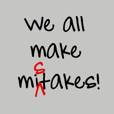 mispelling on the word mistakes in a sign that says we all make mistakes