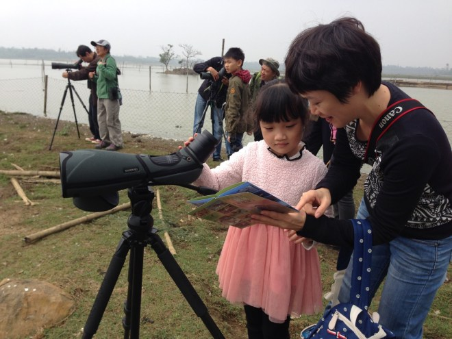 Introducing some of the younger members of th group to birding near Haikou