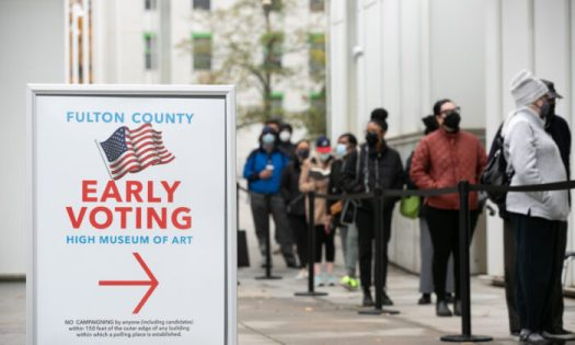 Voters line up for the first day of early voting outside of the High Museum polling station in Atlanta, Georgia on Dec. 14, 2020. (Jessica McGowan/Getty Images)