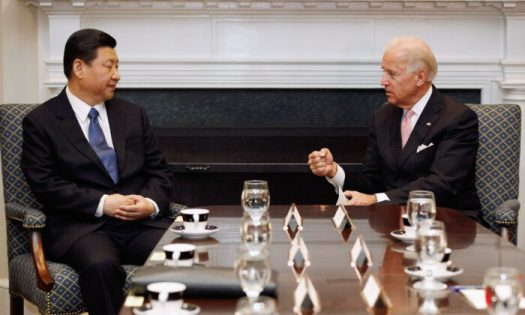 Then U.S. Vice President Joe Biden, a Democrat, (R) and then Chinese Vice Chair Xi Jinping talk during an expanded bilateral meeting with other U.S. and Chinese officials in the Roosevelt Room at the White House in Washington on Feb. 14, 2012. (Chip Somodevilla/Getty Images)