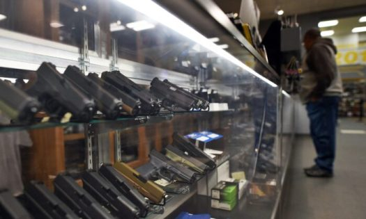A man looks at handguns at a shooting range in Randolph, N.J., on Dec. 9, 2015. (Jewel Samad/AFP via Getty Images)