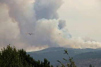 Alberta water bombers returning for refills to fight Little White Fire.