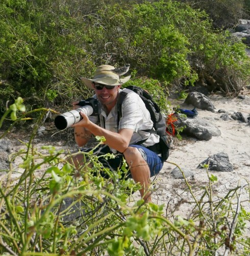 Josh trying to take a photo of a Galapagos Mockingbird; a little hard when it is perched on your hat