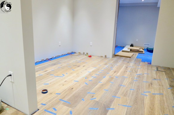 If you are considering installing real hardwood in a basement, an engineered hardwood floor should be your only consideration. Our tutorial explains how to install it the right way! Hardwood floor | Birdz of a Feather | hardwood floor diy | hardwood floor diy install | DIY | tips for installing hardwood floor #birdzofafeather.ca #hardwoodfloor #hardwoodfloorinstallation