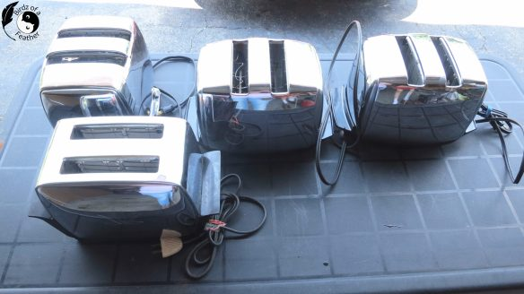 4 toaster on a table for spray paint chrome project