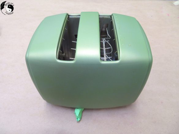 Green primer on spray paint chrome toaster repurpose project