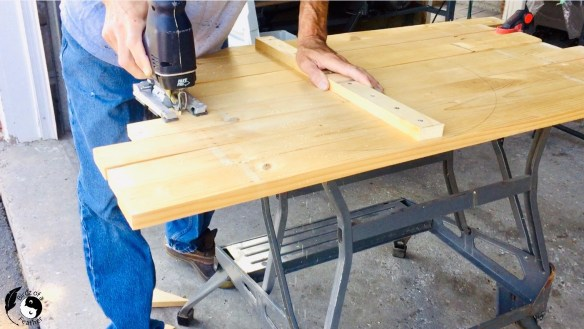 Cutting the pallet wood with a jigsaw for Wooden Wall Art DIY