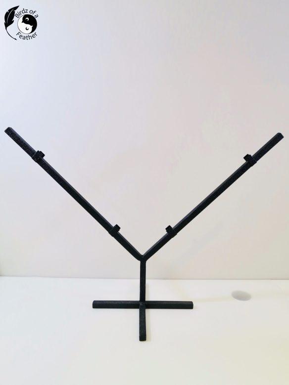 The DIY jewelry display starts with a wrought iron stand