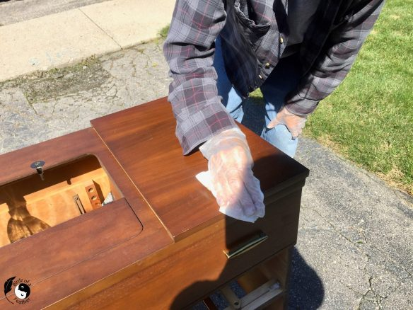 Spray Decon 30 onto a cloth before wiping down wood furniture for how to get smell out of old furniture