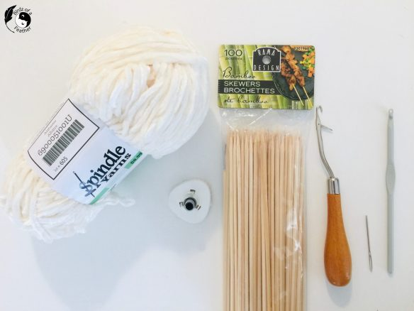 Materials for crochet coral reef pattern sea pen, From left; velour yarn, plastic medical waste cap, skewers, rug latch hook, blunt darning needle, crochet h