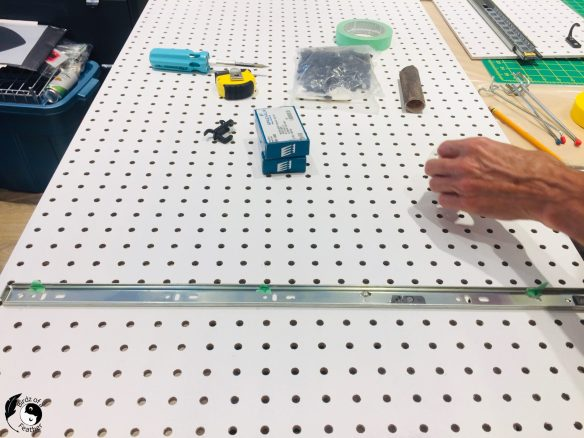 Attaching the drawer slides for the pegboard craft organizer