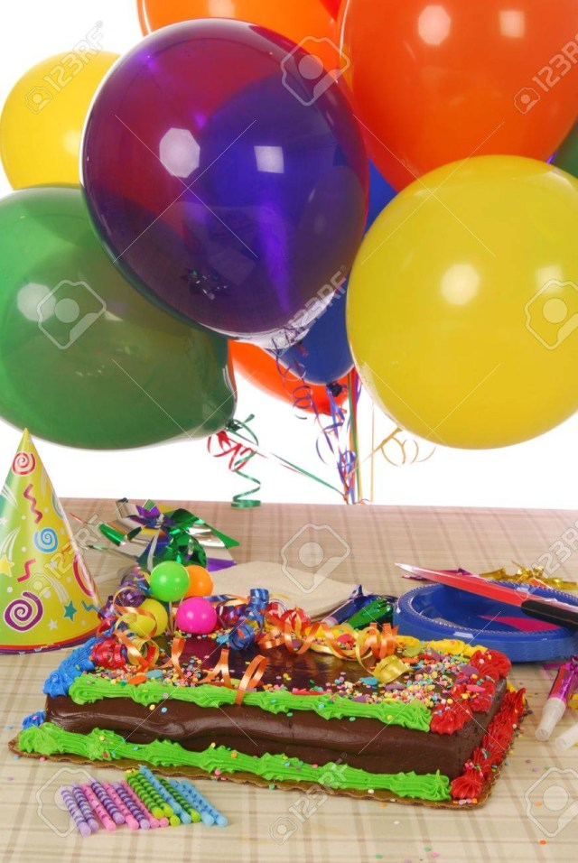 Birthday Cake And Balloons A Birthday Cake With Balloons And Party Favors Stock Photo Picture