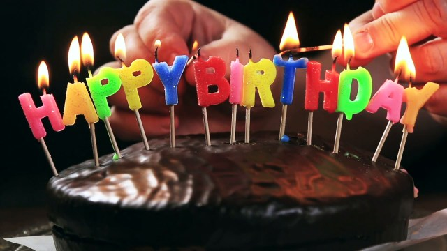 Birthday Cake With Picture Lighted Candles On A Happy Birthday Cake Candles With The Words