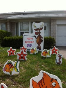 Moose Lawn Sign With Fish And Star Ornaments