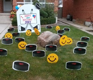 Hockey Lawn Sign with Pucks and Smiley Faces