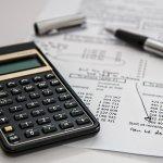 Calculator, receipt, and pen