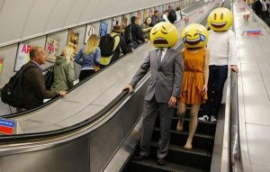 Picture of three emoji people standing on the escalators of the London Underground. This picture was taken for TalkTalk's London marketing campaign.