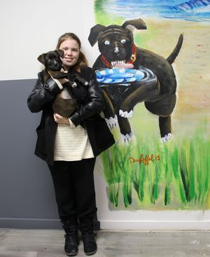 Salem High School Art Student Paints Mural for Doggie Day Care