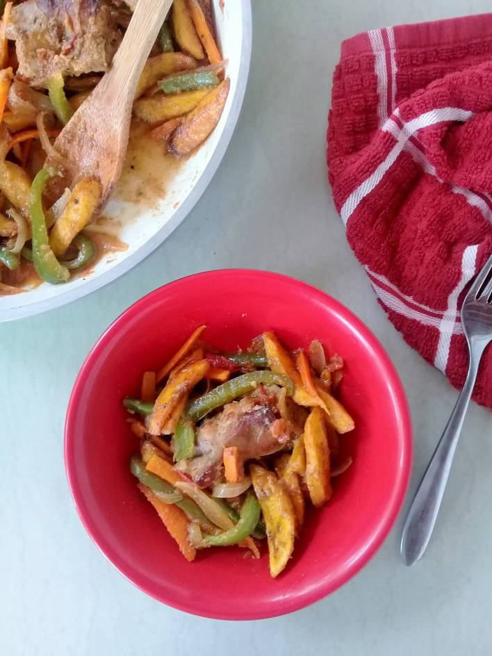 Poulet DG; Chicken, plantain and vegetables from Cameroon.