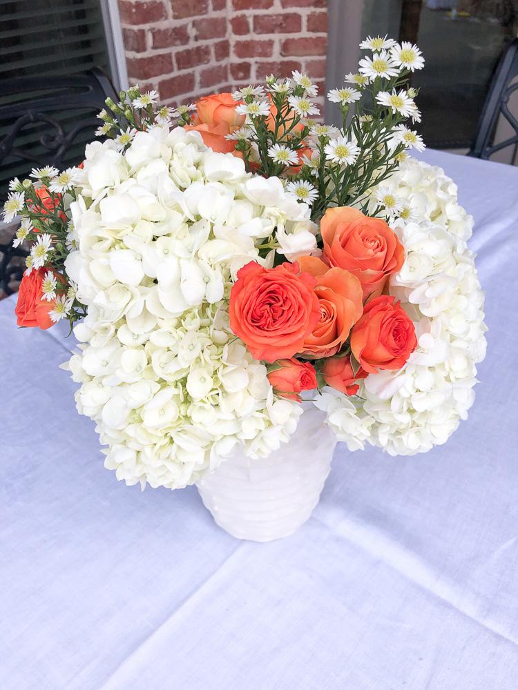 orange and white flower arrangement