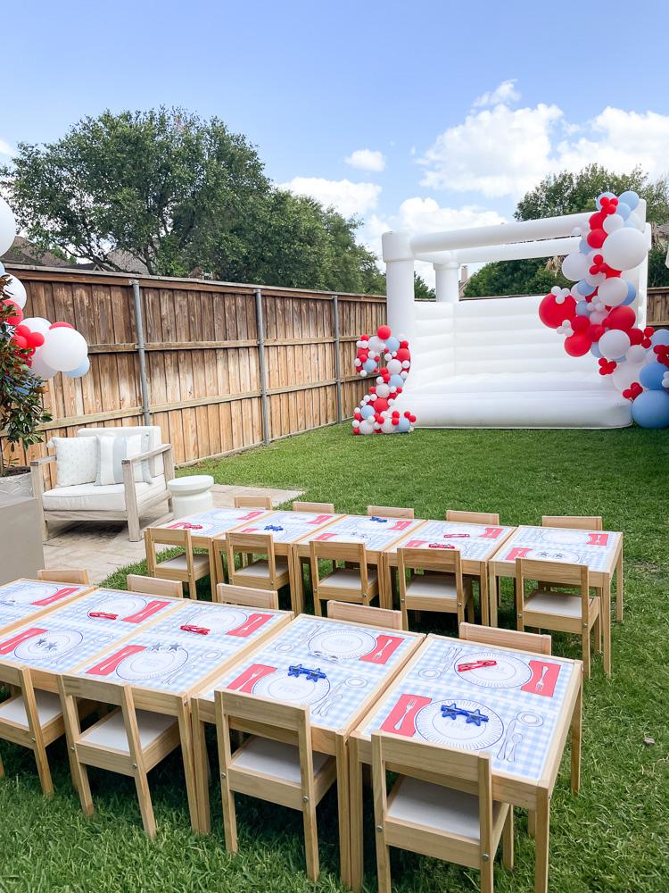 backyard party setup white bounce house