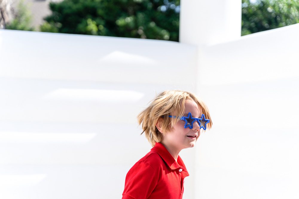 boy with blue star sunglasses
