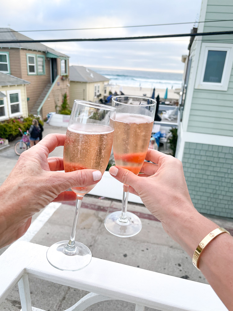 toasting with champagne view to beach