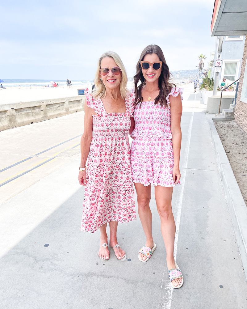 two women in matching print dresses