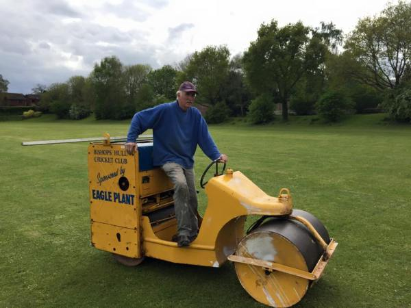 Paul Burbeck hard at work rolling the cricket pitch on Bishop's Hull playing fields