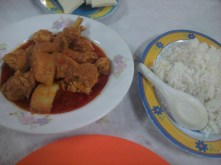 Fusion cuisine - chicken curry with potatoes and rice.