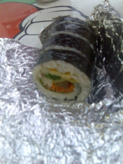 Gimbap (steamed white rice and various other ingredients rolled in gim) - similar to sushi.