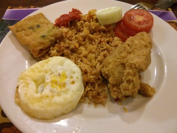 A typical Indonesian hotel breakfast - mie or nasi goreng, roti, vegetables, eggs and sambal - spicy! :)