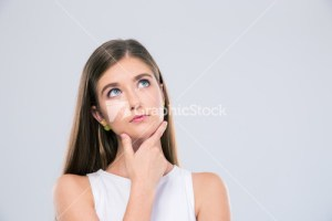 Portrait of a pensive female teenager looking up isolated on a white background