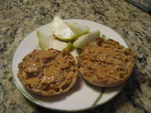 English muffin spread with all natural peanut butter.