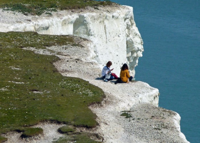 People too close to the cliff edge at Seven Sisters