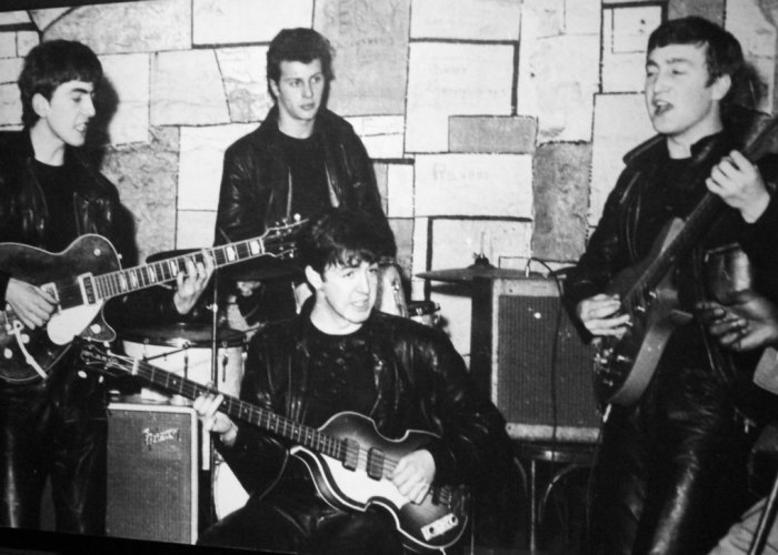 The Beatles at the Cavern: George Harrison, Pete Best, Paul McCartney, John Lennon.