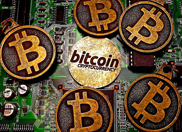 Bitcoin keychains on circuit board (Image: BTC Keychain)