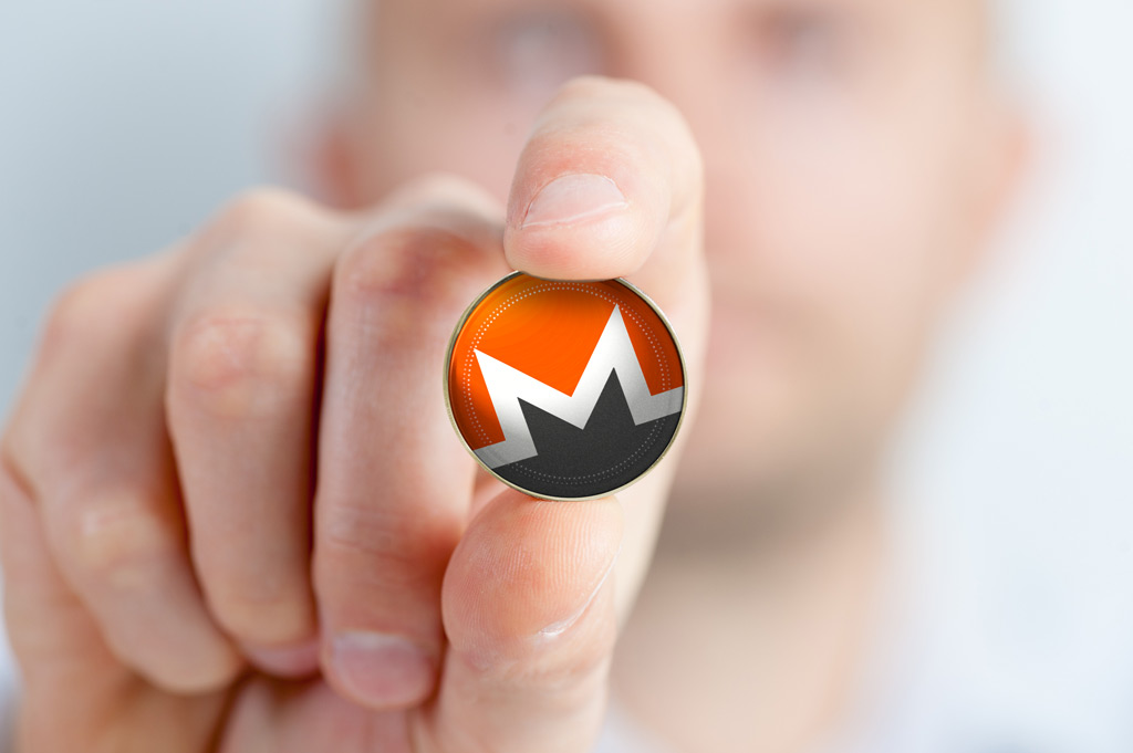 monero-coin-fingertips2-1024×681