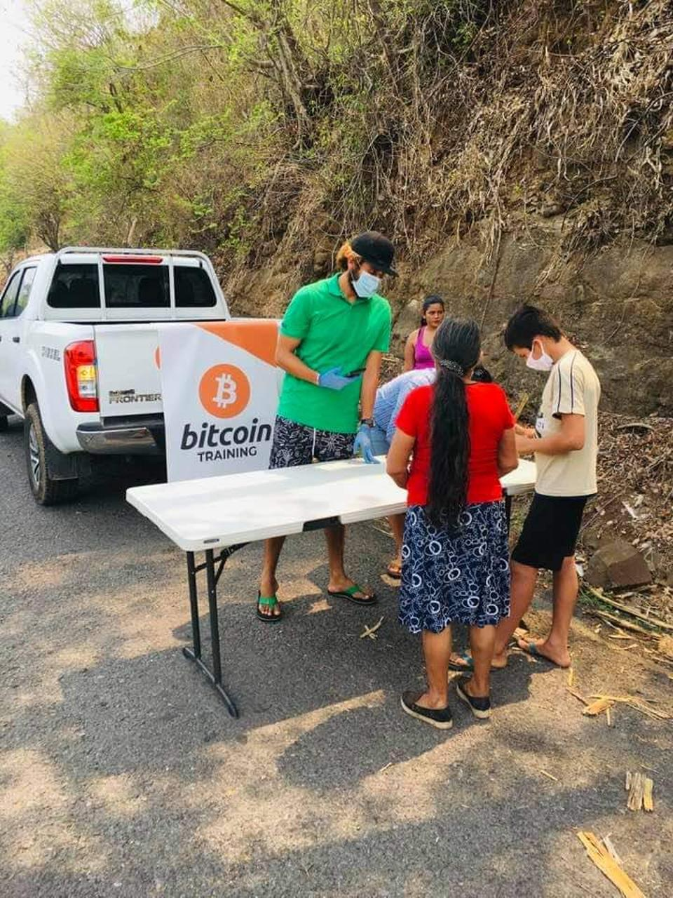 """Roman """"Chimbera"""" Centeno at a Bitcoin training station in El Zonte. Residents scan a QR code to receive their deposits."""