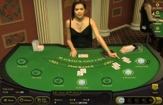 Bitcasino.io Croupier at a live blackjack table