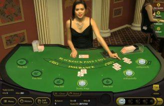 Bitcasino.io Croupier at a live blackjack table