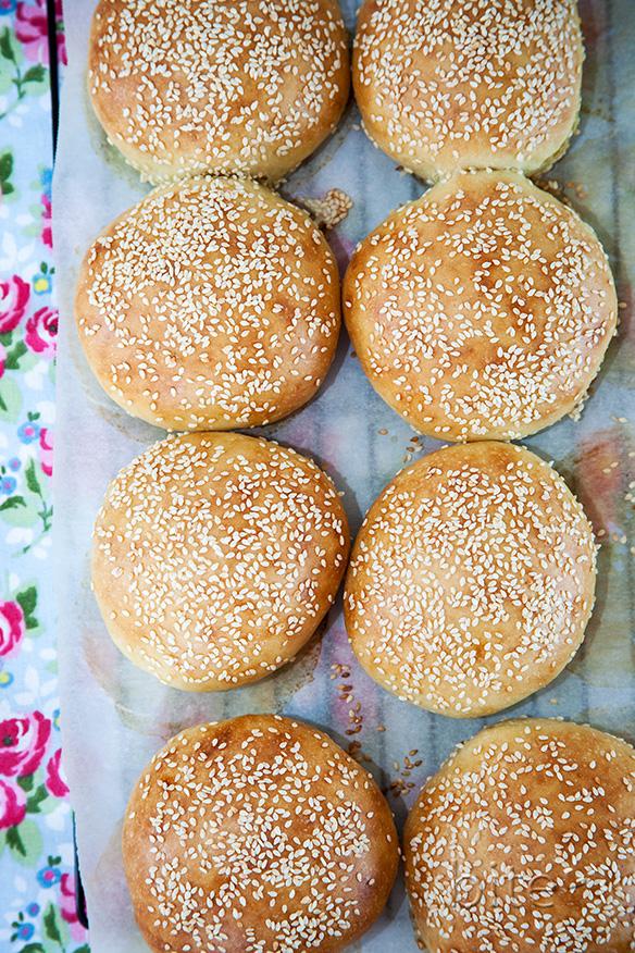 sesame seed hamburger buns on napkin
